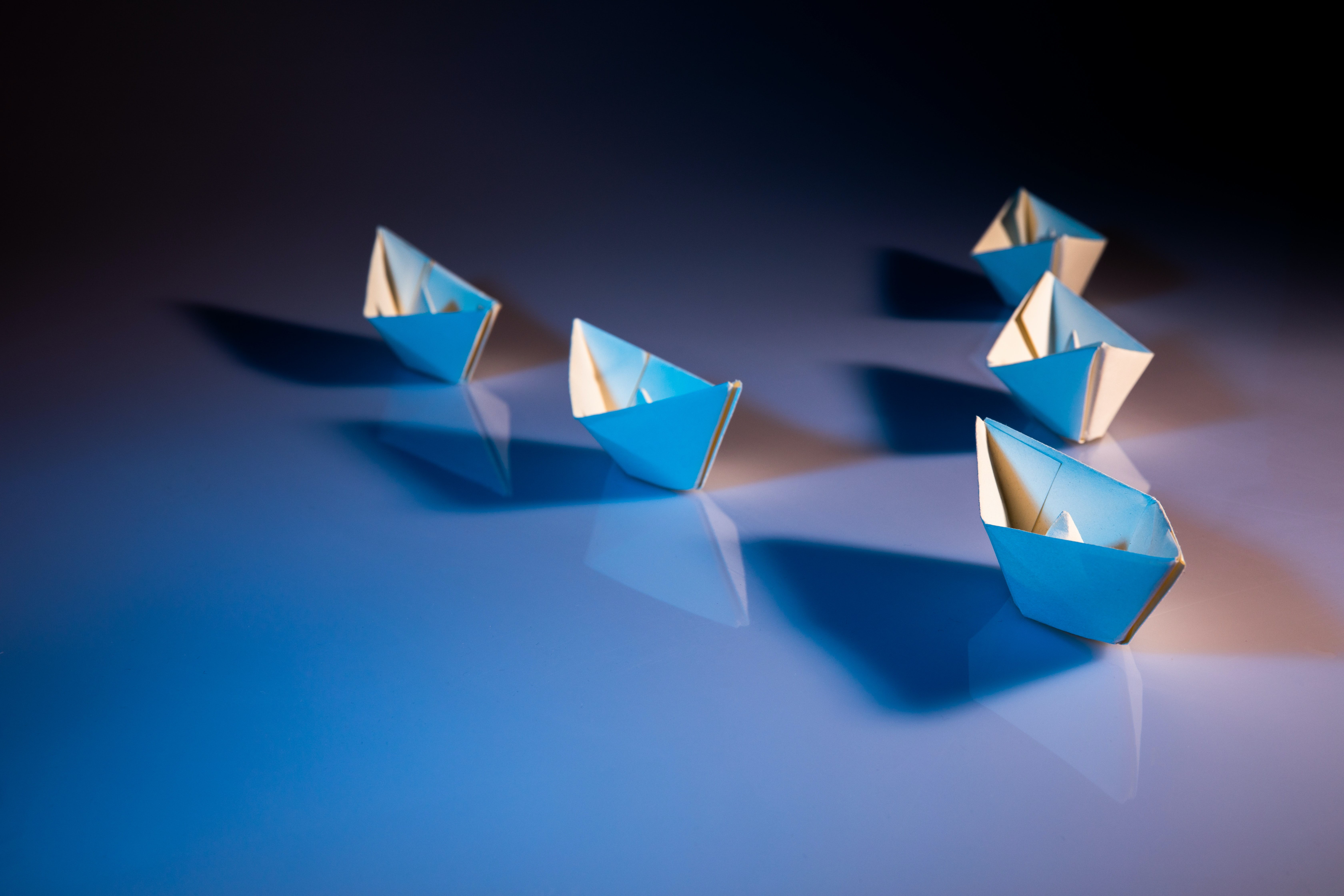Paper boats on water